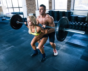 woman lifting weight with belt